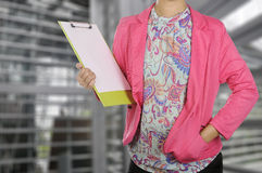 Businesswoman holding clipboard in meeting room Stock Image