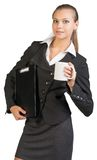 Businesswoman holding clipboard and mug Royalty Free Stock Photography
