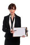 Businesswoman holding clipboard and pen Royalty Free Stock Photo