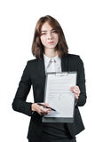 Businesswoman holding the clipboard and the pen. Portrait of businesswoman holding the clipboard and the pen in her hand isolated on white Stock Photos