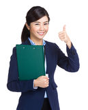 Businesswoman holding clipboard showing thumb up. Isolated on white Royalty Free Stock Photography