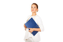 Businesswoman holding a clipboard and thinking about something Royalty Free Stock Images