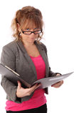 Businesswoman holding a clipboard wearing a jacket Stock Image