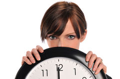 Businesswoman holding a clock Stock Image