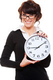 Businesswoman holding clock Stock Image