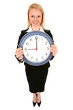 Businesswoman holding clock Royalty Free Stock Images