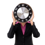 Businesswoman holding clock over face Royalty Free Stock Photography