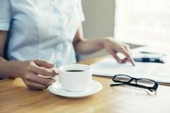 Businesswoman holding coffee cub Stock Photo