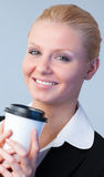 Businesswoman holding a coffee cup Royalty Free Stock Photography