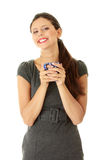 Businesswoman holding coffee cup Stock Photo