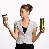 Businesswoman holding coffee cups Stock Photography