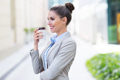 Businesswoman holding coffee outdoors Royalty Free Stock Photo