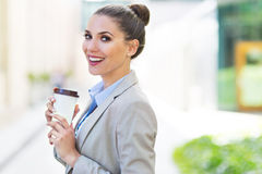 Businesswoman holding coffee outdoors Stock Photography