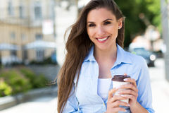 Businesswoman holding coffee outdoors Royalty Free Stock Photography