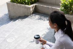 Businesswoman holding coffee outside office building. beautiful Royalty Free Stock Photo