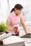 Businesswoman holding coffee to go Stock Images