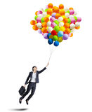 Businesswoman holding colorful balloons - isolated Stock Images