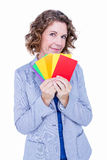 A businesswoman holding colors cards Stock Images