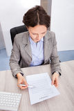 Businesswoman Holding Contract Paper Stock Image