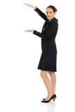 Businesswoman holding copy space in hands. Royalty Free Stock Photography