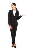 Businesswoman holding copyspace on the left hand Stock Photo
