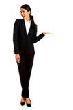 Businesswoman holding copyspace on the left hand Stock Photography