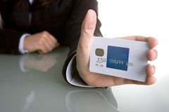 Businesswoman holding credit card in the hand Stock Image