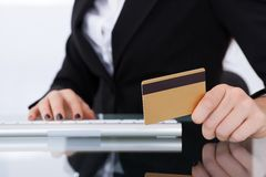 Businesswoman holding credit card Stock Photo