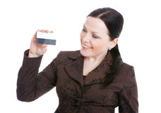 Businesswoman holding credit card over white Royalty Free Stock Images