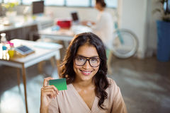 Businesswoman holding a credit card Stock Images