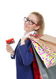 Businesswoman holding credit card with shopping bags Royalty Free Stock Photography