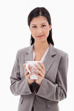 Businesswoman holding cup Stock Image