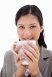 Businesswoman holding cup with both hands Stock Photo