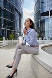 Businesswoman holding a cup of coffee Royalty Free Stock Photo