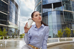Businesswoman holding a cup of coffee Stock Photo