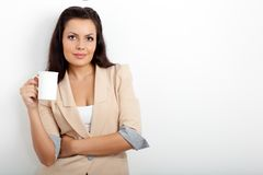 Businesswoman holding cup of drink Royalty Free Stock Images