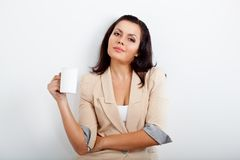 Businesswoman holding cup of drink Stock Images