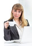 Businesswoman holding cup sitting at desk Royalty Free Stock Photos