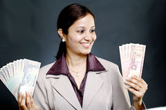 Businesswoman holding currency Stock Photos