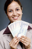 Businesswoman holding currency Royalty Free Stock Photos