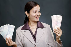 Businesswoman holding currency Royalty Free Stock Image