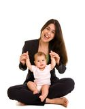 Businesswoman holding daughter Stock Images