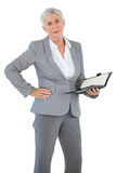 Businesswoman holding diary with her hand on hip Stock Images
