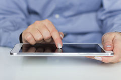 Businesswoman holding digital tablet Stock Photography