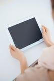 Businesswoman holding digital tablet at desk Stock Photos