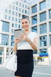 Businesswoman holding a digital tablet in hands outdoors Stock Image