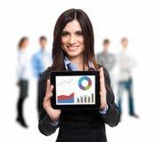 Businesswoman holding a digital tablet Stock Photos
