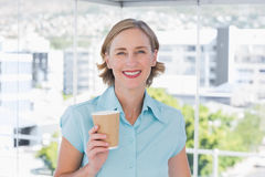 Businesswoman holding disposable coffee cup Stock Images