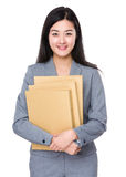 Businesswoman holding with document work Stock Photos