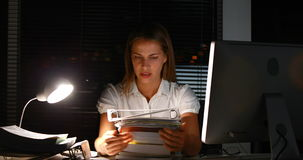 Businesswoman holding documents at night stock video